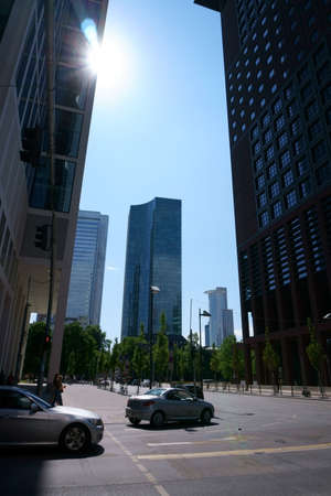 Frankfurt, Germany - April 18, 2019: Various skyscrapers as the Westend Tower and the Deutsche Bank skyscraper on New Mainzer Road on April 18, 2019 in Frankfurt. Editorial