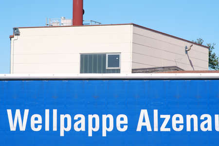 Alzenau, Germany - September 21, 2019: The logo of Corrugated Paper Alzenau, a manufacturer of packaging and packaging materials, at industrial building on September 21, 2019 in Alzenau.
