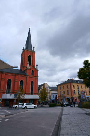 Limburg, Germany - September 28, 2019: The side view of the red facade and the bell tower of the Evangelical Church on September 28, 2018 in Limburg.