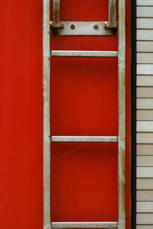 The closeup of a body of a fire truck with a ladder. Banco de Imagens