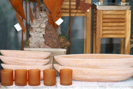 Various clay bowls or bowls made of terracotta on a sales stall with artisanal objects.