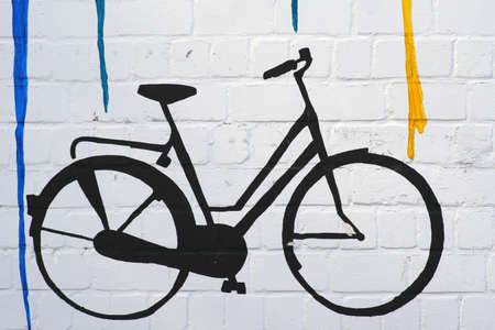The drawing and the outline of a bicycle on a wall with color gradients.    Banco de Imagens