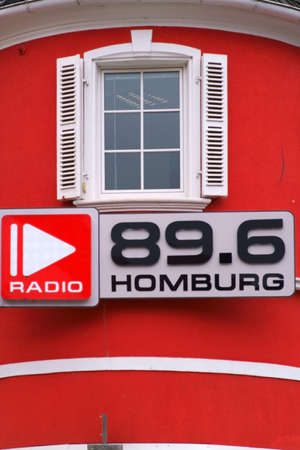 Homburg, Germany - October 19, 2019: The red facade and the sign of radio station 89.6 Homburg on October 19, 2019 in Homburg.