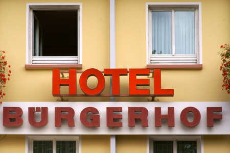 Homburg, Germany - October 19, 2019: The hotel sign of the Hotel Buergerhof with a yellow facade and flower decorations on 19 October 19, 2019 in Homburg.