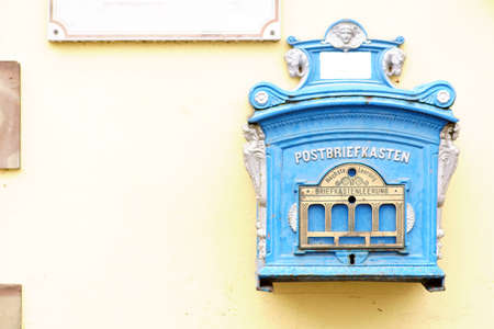 An old nostalgic mailbox on a yellow house wall. Banco de Imagens