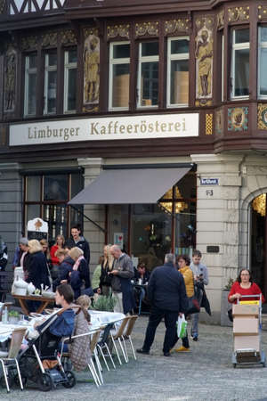 Limburg, Germany - October 12, 2019: The landmarked half-timbered facade of Caf? Limburger Kaffeer?sterei decorated with gold and motifs on October 12, 2019 in Limburg.
