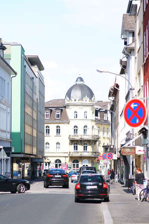 Giessen, Germany - August 13, 2019: Traffic in the city center of Giessen with department stores and commercial buildings on August 13, 2019 in Giessen.