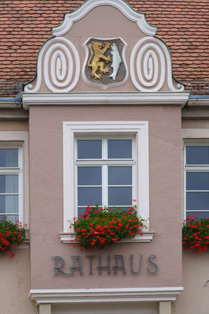 The close-up of a gable window of the town hall in Waldfischbach. Editorial