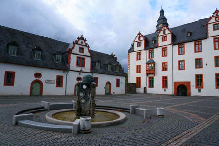 The forecourt of Hadamar Castle with a fountain in front of the Glass Museum. Editorial