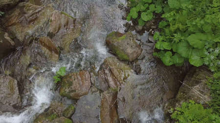 topview of water moveing down at small waterfall