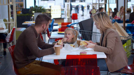 Nice family eat in the shopping mall Banco de Imagens