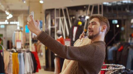 Happy guy takes a selfie with a jacket Banco de Imagens - 133698946