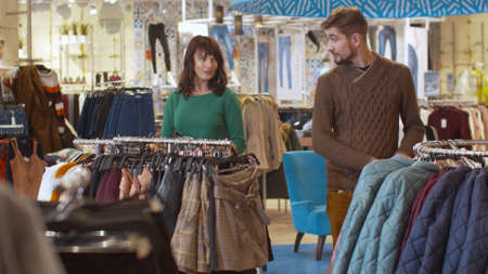 Man and woman flirt in the store