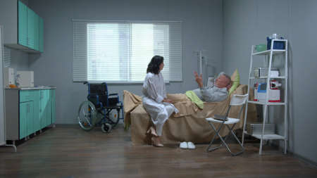 Doctor sit and talk with patient in hospital Banco de Imagens