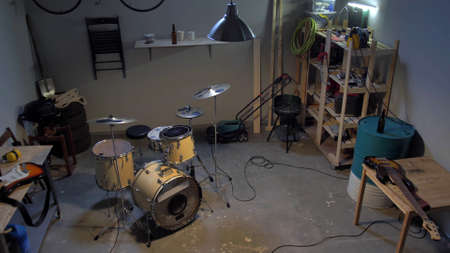 Drum kit in a garage for rehearsing music bands