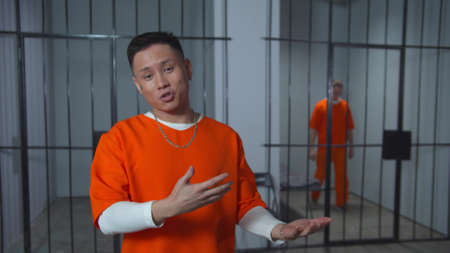 Asian prisoner speaks to camera. Interview with the criminal