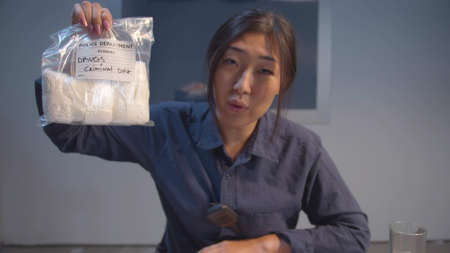 A cop shows a package of drugs as evidence