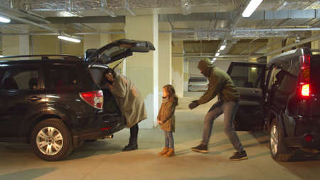 Abduction of a girl in a parking lot while mom was busy Stock Photo