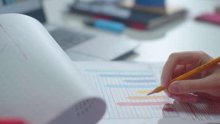 Employee views documents and enters data on a computer Фото со стока