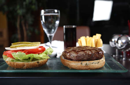 Front shoot of a burger and french fries