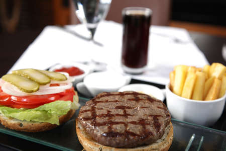 Open Burger with french fries sauces and cola