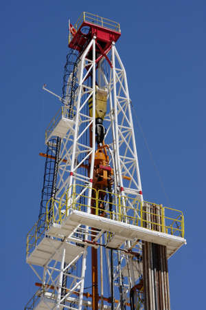 drilling well: Oil pump estractor isolated on blue sky