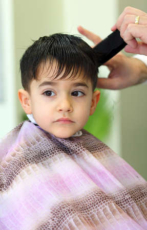 A lovely child in the hairdresser salon cutting his hair Stock Photo - 11961559