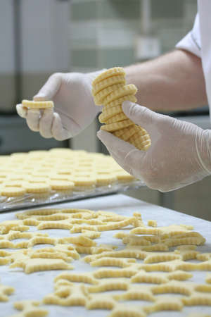 traditions: Pastry making biscuits with white gloves Stock Photo