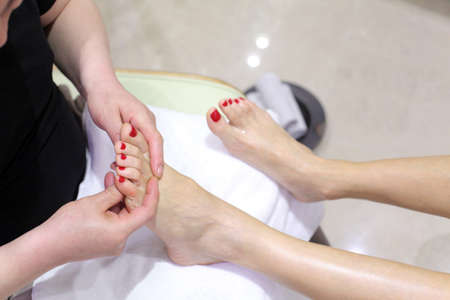 Foot care in a beauty foot salon photo