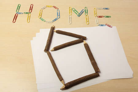 Home with paper clips and with wood pencil photo