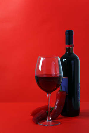 Red wine and glass with red background photo