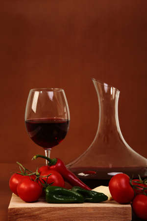Red wine and glass with red background with vegetales Stock Photo - 13497690