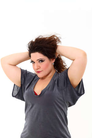 Sexy plus size woman in grey shirt