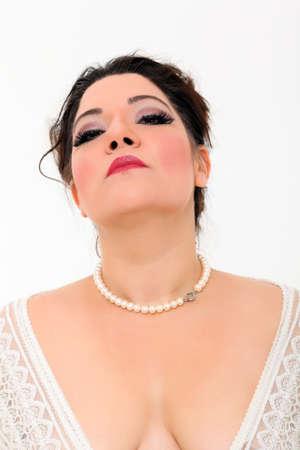 Pretty plus size woman with white dress photo