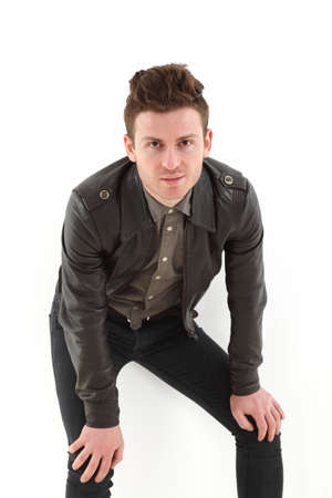 Young russian model on white background with leather jacket photo