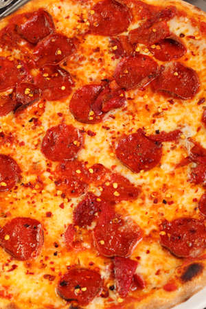Italian pizza with hot chilli and salami photo
