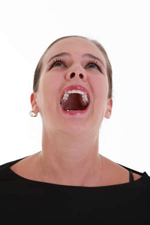 facial gestures: Portrait of afraid screaming young woman