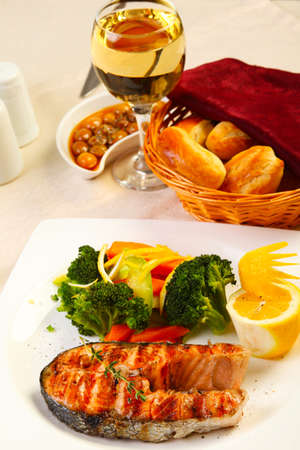 Delicious salmon grilled with broccoli lemon and bread photo