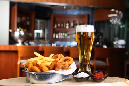 calamares: Fried calamar with a glass of beer in pub