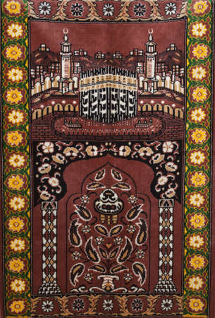 Red Seccade muslim carpet for daily pray photo