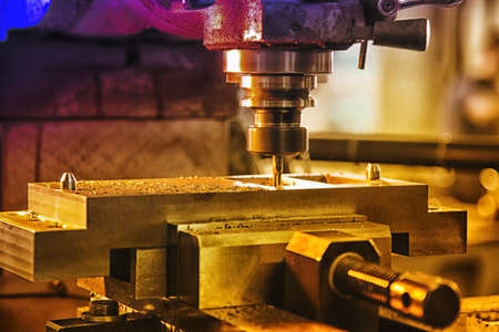 Industrial desk driller working on steel