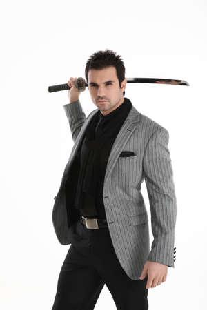 Elegant handsome man with a katana sword Standard-Bild