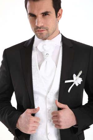 handome: Portrait of handome man in tuxedo Stock Photo