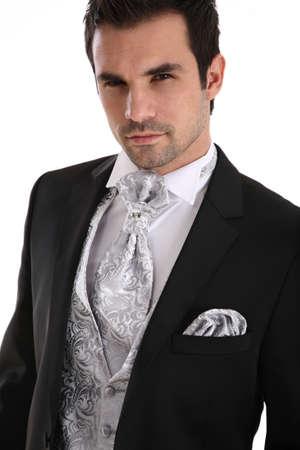 the groom: Handsome caucasian man in tuxedo
