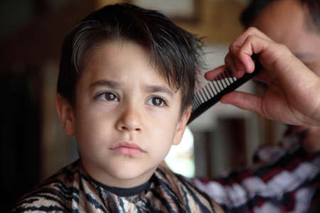 beauty shop: Male child at the barber shop to cut the hair
