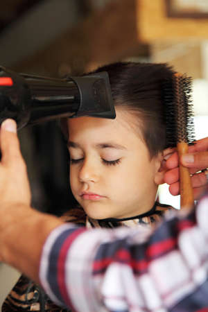 phon: Male child at the barber shop to cut the hair