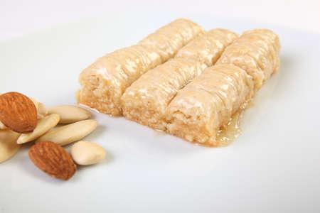 durum: Typical turkish dessert durum with almonds on white background