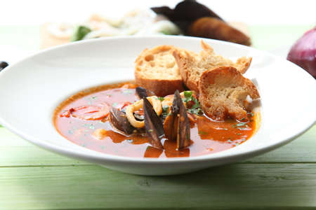 Fish soup with tomatoes,mussels and baked bread