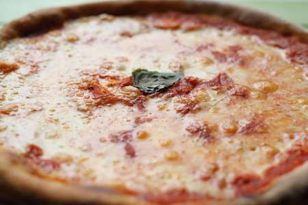 Fresh Pizza margherita in ambient light blurred Standard-Bild