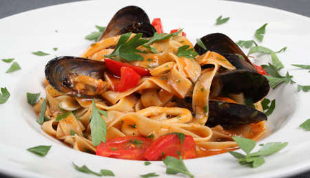 A perfect italian sea food fettuccine and mussels